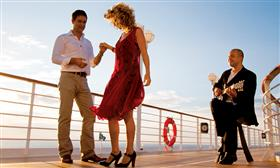 Two passengers dancing on the deck of the Azamara Quest.