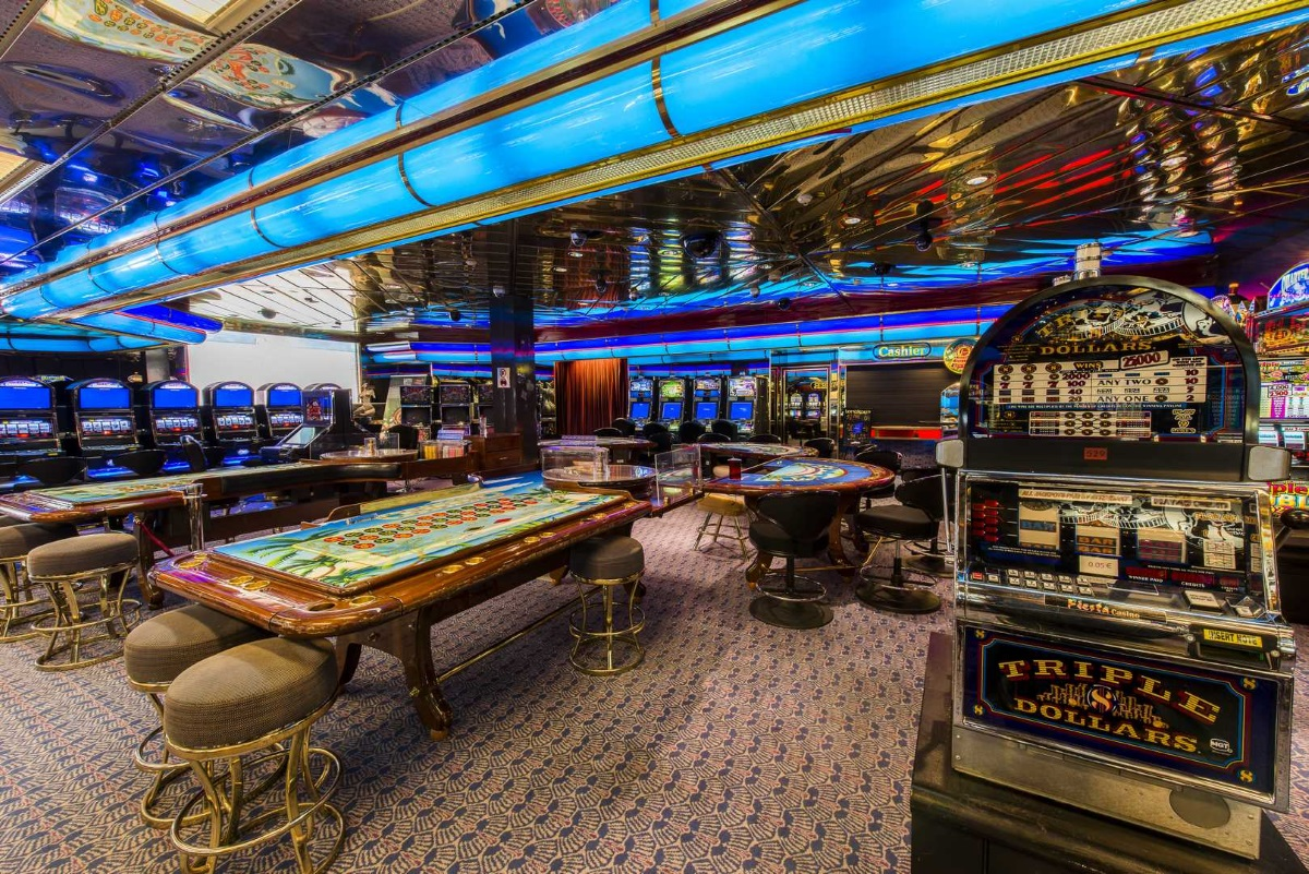 Gaming tables and slot machines at the casino onboard Celestyal Olympia.