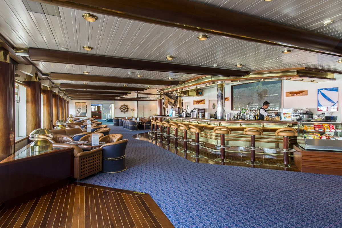 The warm and cosy atmosphere with a nautical theme of the Argo Bar on Celestyal Olympia.