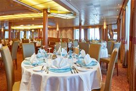 A detail of the elegant main dining room on Celestyal Crystal.