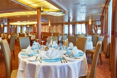 A detail of the elegant main dining room on Celestyal Crystal.